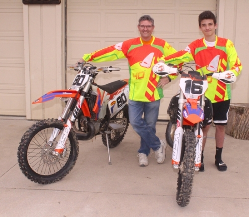 Pat Flynn (left) stands alongside his grandson, Logan White, with the motorcycles they use for cross country racing. While Flynn has been competing in national races for more than 30 years, this year marks the first time that his grandson, 15, has joined him.