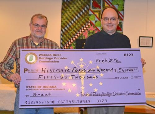 Dave Hacker (left)and Jim Scheiber, president of the Historic Forks of the Wabash board, display the check for a grant that will allow the development of an island adjacent to the Historic Forks property.