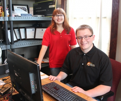 Alex Forsythe (left) and her brother, Scott Forsythe, work at Scott's computer in the office of their home near Bippus. The two siblings completed internships this summer working at NASA.