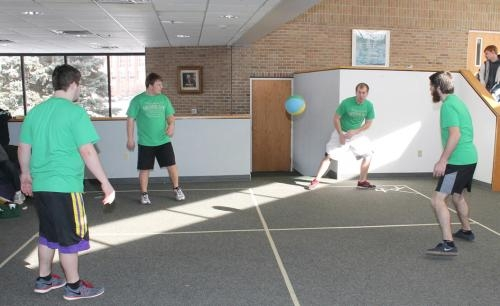Four Huntington University students play a game of four square in the Baker/Roush Hall lounge on campus on Friday, Jan. 24, in an attempt to break the Guinness World Record for longest marathon playing four square.