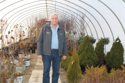 Wayne Fox stands inside a greenhouse at Huntington Nursery & Florist, where he has worked for 51 years. Fox was also the owner of the business for a long time, selling it in 2008, but he opted to stay on to help out and continue doing work he says he loves.