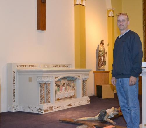 Rob Mayo, operations manager at St. Felix Friary, stands in the sanctuary of the friary's chapel.