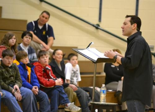 """Joel Froomkin reads to a group of area students last school year during """"Page on Stage,"""" a program that brings the text from plays and popular literature to life."""