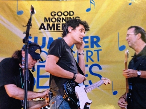 "Huntington native and audio technician John Gernand (left) applies a microphone to musician John Mayer (middle) while musician Eric Clapton looks on prior to a concert on ""Good Morning America"" in New York City's Bryant Park in 2007. Since 1979, Gernand has lived in the Big Apple, where he works professionally in audio."