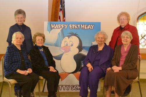 Members of the Penguin Club, formed by a group of high school girls in 1939, celebrate the 90th birthday of the club's youngest member on Saturday, Feb. 9.