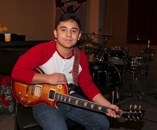 Local guitarist and Huntington North High School student Jesse Gonzales takes a break from practice on Friday, March 17. Gonzales and his band, The Timebacks, will perform in a benefit concert on Friday, April 21, at the HNHS auditorium.