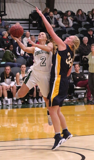 Miranda Palmer (left), a senior guard on the Huntington University women's basketball team, rises to the hoop for a basket during a game against visiting Spring Arbor University earlier this season on Jan. 7. Palmer became the program's all-time leading scorer this season, breaking Amy Bechtel's record of 2,019 points, set in 2000.