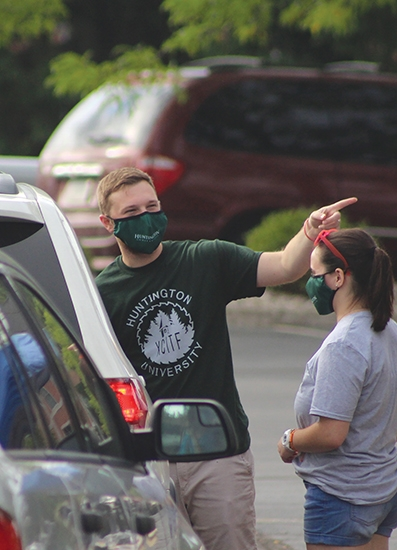 Guiding new Huntington University students during new-student orientation on Thursday, Aug. 27, is Admissions Counselor Brayten Carpenter. Huntington University held the majority of their move-in day orientation events outside in an effort to stay socially distanced.