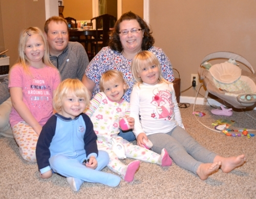 Joel and Jennifer Harris (back), along with their children (from left) Aubrey, 8; Landry and Caroline, both 3; and Meredith, 4, recently returned from two and a half years in the Dominican Republic — a move that introduced the youngest children, for the first time, to the need for jackets and socks.