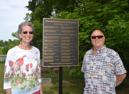 Jo (left) and Bob Ramsdell stand with the bronze plaque they erected at Pilgrims Rest Cemetery. The plaque memorializes 20 of Bob's ancestors who are buried in unknown locations, many at Pilgrims Rest.