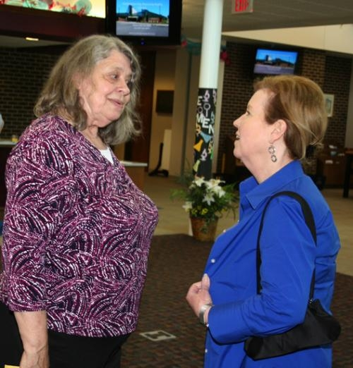 Huntington City-Township Public Library Executive Director Kathy Holst (left) chats with Janelle Graber, the director of the Eckhart Public Library in Auburn, during a retirement reception for Holst held at the Huntington Branch on Friday, June 13.