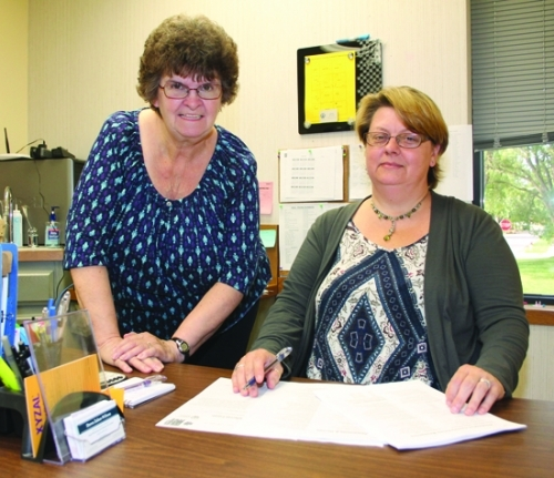 Rosella Stouder (left) and Dawn Zahm-Wilson coordinate and administer the Rapid Rehousing & Homeless Prevention Program (RRHP), which recently received additional funding to continue helping Huntington County residents from becoming homeless. The program is under the umbrella of Community and Family Services.