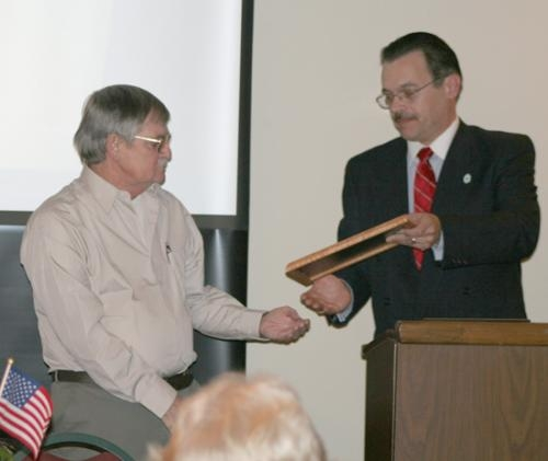 "Jim Miller (left) was presented with the ""Hometown Hero of the Year,"" award by Mike Rohler, executive director of the Huntington Chapter of the American Red Cross on Saturday, March 6."