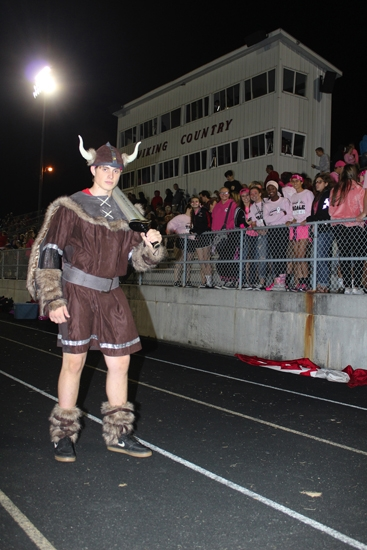 Eli Link, a senior at Huntington North High School, stands before the school's student section, The Pit, in character as Ike the Vike, the school's mascot, during a varsity football game at Kriegbaum Field on Friday, Oct. 7. Appearances by the student-portrayed mascot had waned in recent years at the school, but Link and Huntington North Athletic Director Kris Teusch are hoping to reignite the tradition.