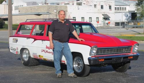 Drag racer Gerald Ingle, of Huntington, stands with his current race car, a '66 Chevy 2 station wagon. Ingle has been drag racing for 35 years.