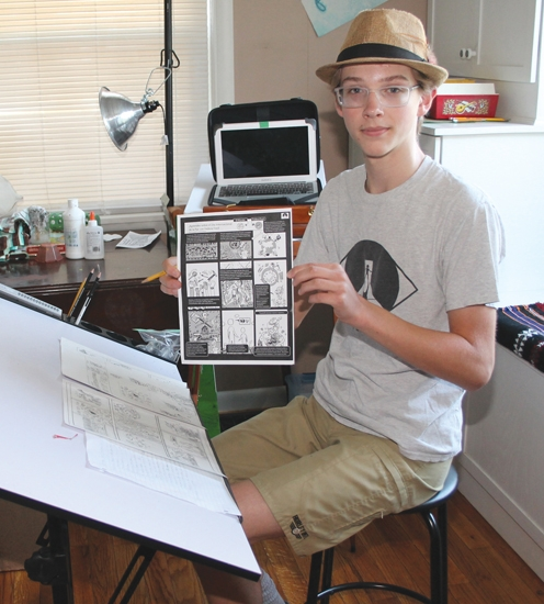 Jaq Webb, of Huntington, a junior at Huntington North High School, holds the comic-strip style flyer he created providing several resources and suggestions for those interested in celebrating peace and taking care of the Earth's environment. The flyer is available in both English and Spanish.