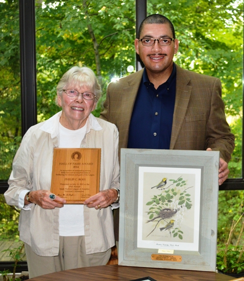 Jean Ross (left) displays awards given to her late husband, Phillip Ross, for his contributions to the Izaak Walton League. Their son-in-law, Robert Goings (right) serves as the league's current president in Huntington County.