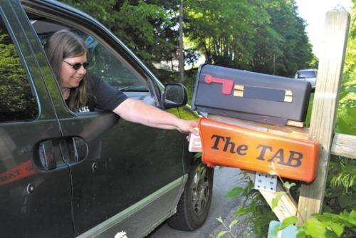 Huntington County TAB carrier Julie Whitacre, who has delivered an estimated 1 million copies of the newspaper over the last 15-plus years, makes her latest delivery.