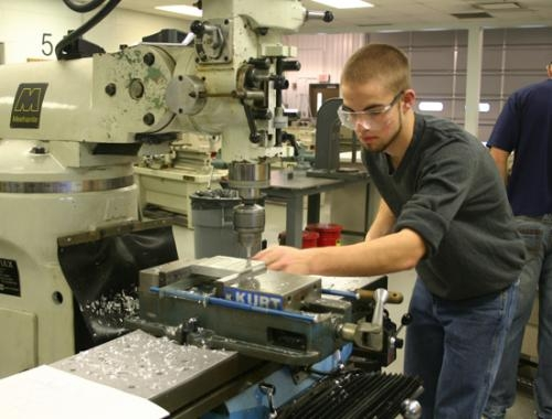 Roger Jones, senior vocational student at Huntington North High School, practices edgework for the upcoming Indiana National Tooling Machining Association competition on Saturday, Jan. 19.