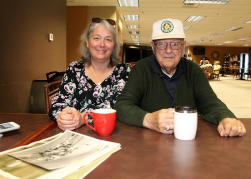Melissa Killen (left) sorts through photos showing the Killen family farm as it has changed through the years with her father, Donald Killen, during coffee time together at the Café of Hope, in Huntington. Donald Killen still lives on the homestead, which was recently recognized as a Hoosier Homestead Farm for being in the Killen family for more than 100 years.