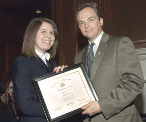 Dave Schiappa (right), Republican secretary of the United States Senate, poses with Huntington resident Sara King after the Senate page graduation in Washington D.C.