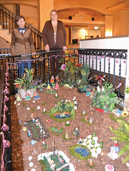 "LaFontaine Center residents Lorraine Dunford (left) and Rose Hawkins spearheaded the creation of the ""Fantasy Gnome and Fairy Garden"" in the center's lobby."