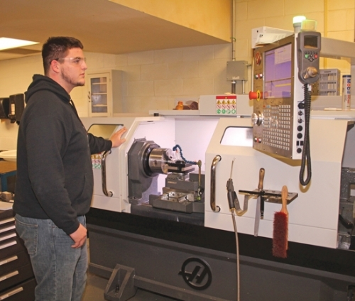 Jack Curless, a senior at Huntington North High School, concentrates on a radius project in his precision machining class at the Huntington County Community Learning Center on Feb. 25. The Learning Center strives to help fill in-demand positions in the local manufacturing sector. Employees with experience running computer numerical control machines are currently sought after.