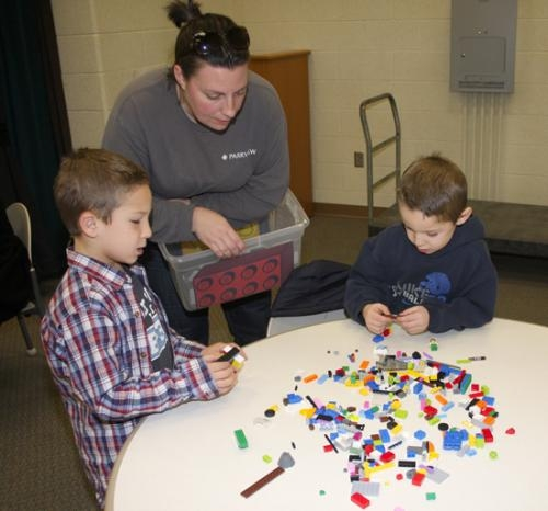 Flint Springs LEGO Club Leader Keely Oswald (center) talks with club members Evan Camomile (left) and his brother Parker about their project on Thursday, Dec. 13. The club is open to Flint Springs second and third-graders and meets twice each month.