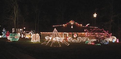 Bill and Kelley Miller, of Huntington, plan an elaborate Christmas lights display each year at 3951W-700N.