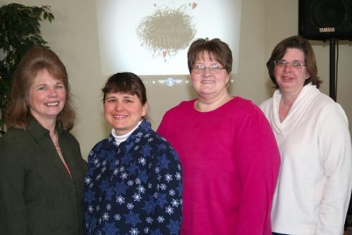 Members of Mothers of Preschoolers — known as MOPS — take a moment from their meeting on Tuesday, Feb. 25.