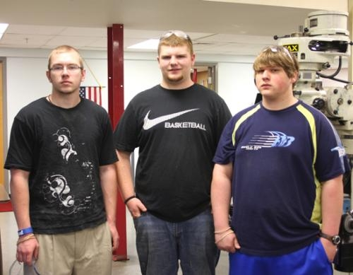 Hunter Haney, Brandon Satterthwaite and Matt Caley (from left) are graduating precision machining students from Huntington North High School who have obtained permanent full-time employment at Micropulse Inc. in Columbia City.