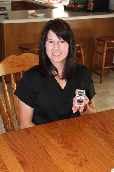 Leigh Gray Martin, a Markle resident and 1984 graduate of Huntington North High School, holds her class ring, which was found and returned to her this summer after being lost in Lake Huron for 31 years.