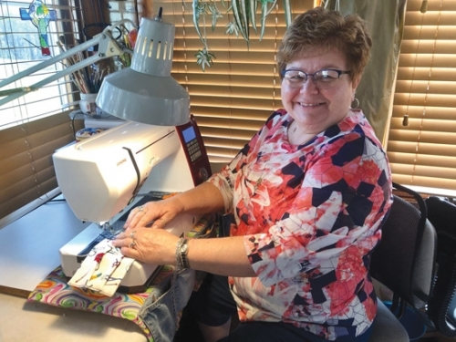 Delene Swing is part of a group of people from Evangelical United Methodist Church, in Huntington, who are putting their sewing talents to work making cloth masks for healthcare workers. Swing estimates she has made more than 200 masks on her sewing machine at home.