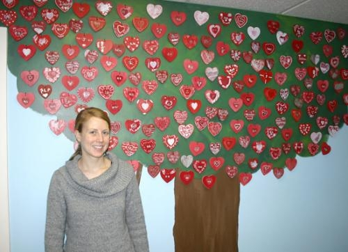 Amber Hirschy, executive director for McKenzie's Hope in Huntington, stands in front of one of the trees of hearts at the facility on Tuesday, April 20.