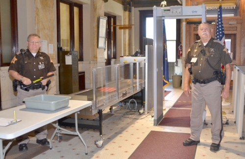 Officers Mel Hunnicutt (left) Rod Jackson help guarantee the security of the thousands of people who visit the Huntington County Courthouse each month, as well as those who work inside the building.