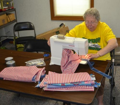 Betty Michel stitches the handles on a fabric bag at Evangelical United Methodist Church on Thursday, Aug. 1. Volunteers sewed more than 450 bags for the Huntington County Literacy Coalition as part of Mission: Huntington.