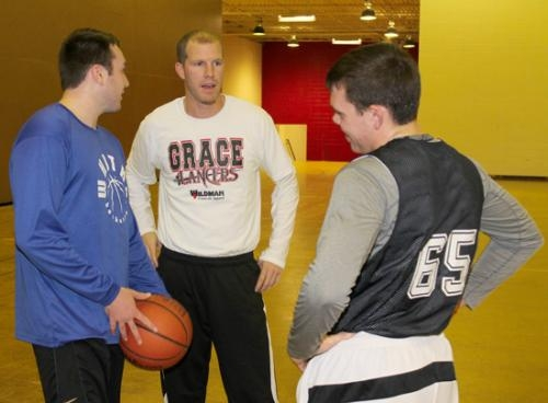 Marcus Moore (center), an assistant coach for the Huntington North boys' varsity basketball team, talks to players Matt Hogan (left) and Keaton Irwin during practice.