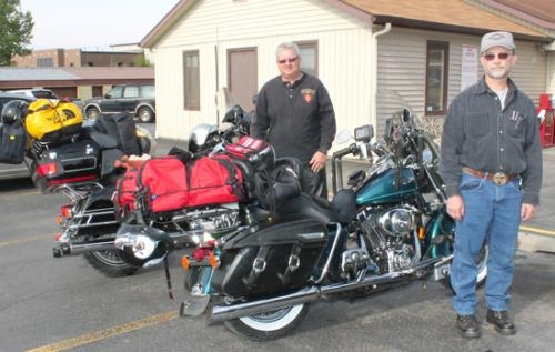 Gary Lewis (left) and Steve Bryan, both of Huntington County, stand with their motorcycles outside The Country Post, in Huntington, on Sunday, May 26, before departing to attempt the Four Corners ride.
