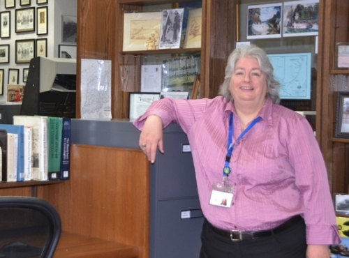Sarah Kirby, librarian in the Huntington City-Township Public Library's Indiana Room, has a career that began in rocket science and has evolved into library science.