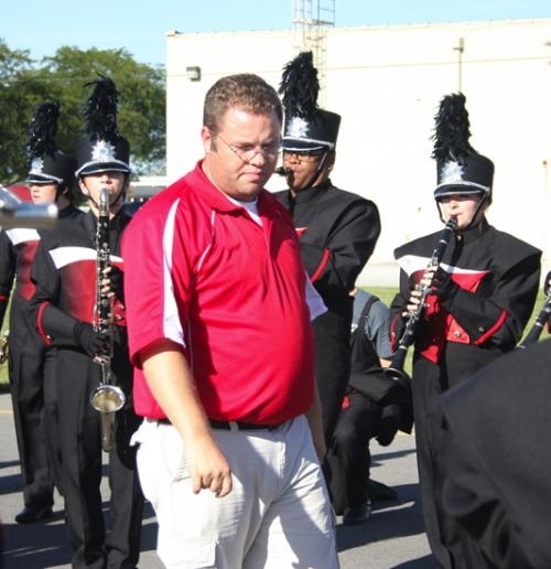Josh Huff, Huntington North High School's new band director, listens intently to his band perform in preparation for the Homecoming Parade on Sept. 27.