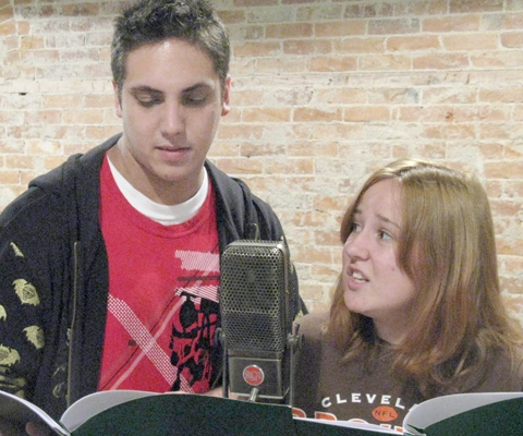 "Lucas Esch, left, and Paige Fisher rehearse for ""Night Chills"" by Edgar Allan Poe at the Pulse Opera House recently."
