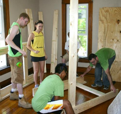 Students from various local churches help build bunk beds at the Malta House in Huntington as part of Operation Backyard on Saturday, July 17.