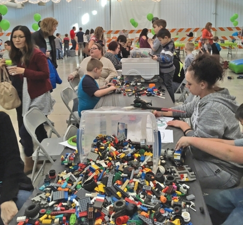 Boys and their moms participate in activities including playing with Legos at the 2018 Mother-Son Extravaganza event sponsored by the Huntington Parks and Recreation Department. This year's event will take place March 2 at the First Merchants Heritage Hall on the Huntington County Fairgrounds.