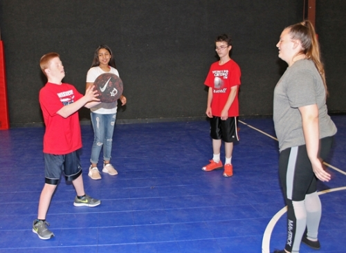 Jon Sizemore (left), 13, catches a basketball during some interaction time at the Parkview Boys & Girls Club of Huntington County Thursday, June 21. Also participating in the game are (from left) Alexia Ramirez, 12, Mitchell Parker, 16 and Ella Emery, 13. Members of the club hang out with Pathfinder teen clients each morning, doing fun things such as using the computer, watching videos and cooking.