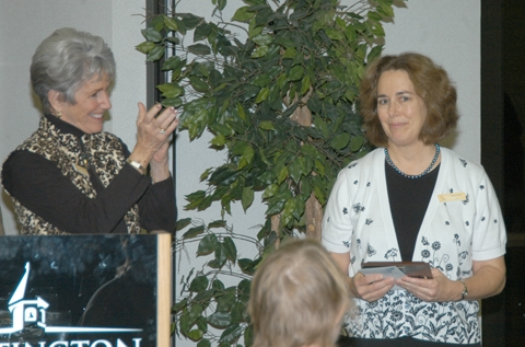 Barb Hancher (left) applauds Nancy Lewis after Lewis received one of two Timothy Hancher Direct Service Awards during the Pathfinder Services recognition dinner on Saturday, Nov. 7.