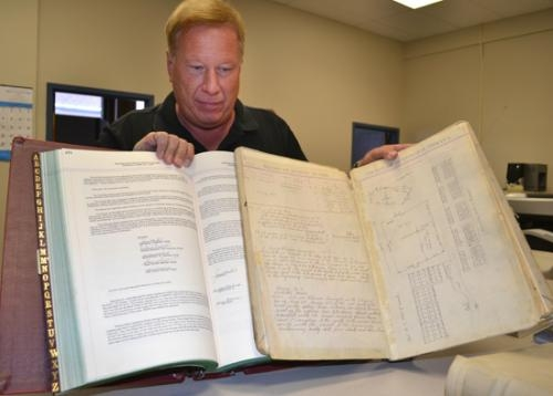 Huntington County Surveyor Jay Poe displays two record books maintained by his office.