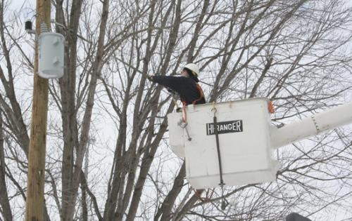 REMC employee Felix Vanner installs a new pole and transformer at a residence on West Maple Grove Road on Thursday, Jan. 14. The removal of a rotten pole and installation of the transformer was part of REMC's improvement efforts.