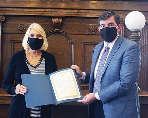 October has been pronounced Respect Life month in Huntington County. Debbie Stoffel, treasurer for Right to Life in Huntington, stands with Mayor Richard Strick to display the Respect Life proclamation, which was signed on Friday, Oct. 2.