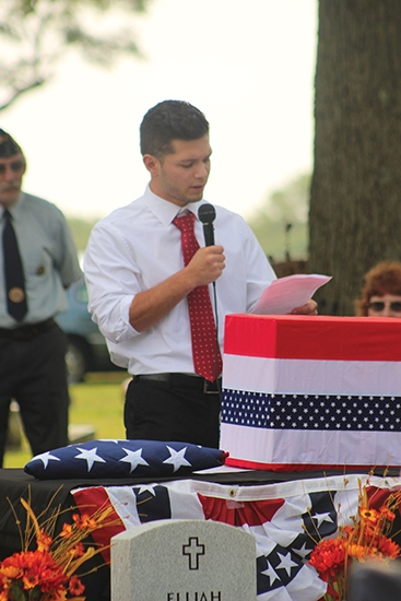 """Reciting a poem titled """"Brotherly Heroes"""" during a rededication ceremony for Revolutionary War veteran Elijah Mitchell and for Vietnam War veterans Mike and George Bustos on Saturday, Sept. 12, is Gage Bustos, of Huntington. The poem was written by family member David Bustos."""