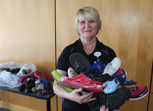 Deb Christman, a dietary aide at Parkview Huntington Hospital, holds just a few of the new and gently used shoes she has collected for the upcoming Huntington County Relay for Life. A hospital-wide drive to collect shoes will begin March 1. Drop-off boxes will be located in the hospital lobby and the public is invited to help fill them with all types of footwear.